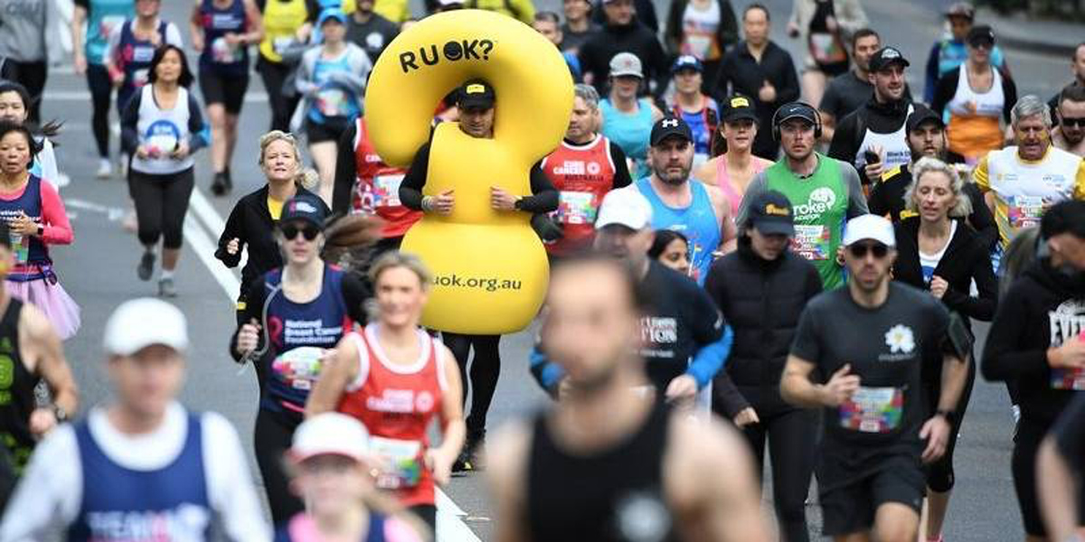 RUOK Question Mark runner in Canberra marathon