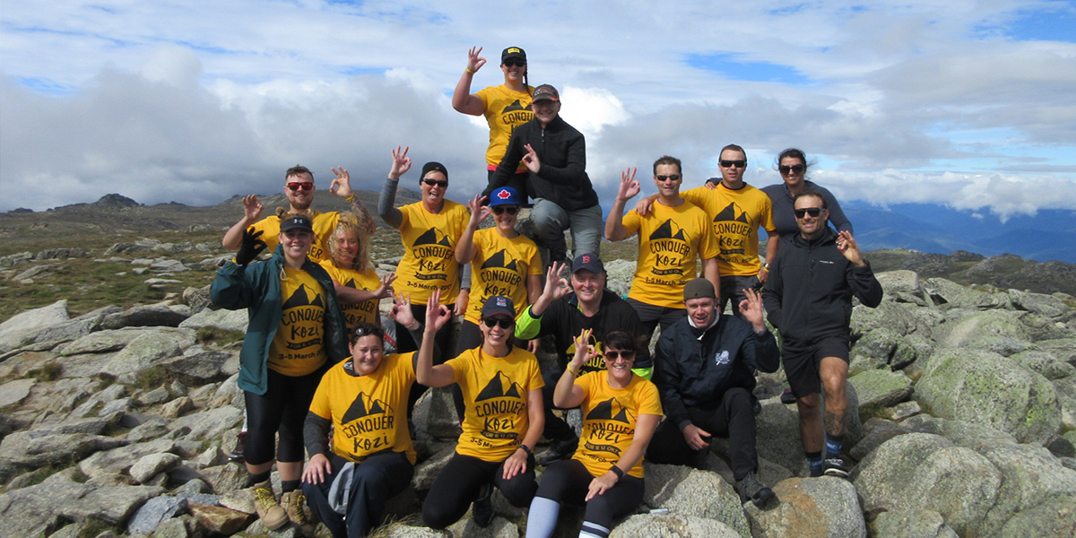 A group on top of Mt Kosciuszko, they took on the challenge to raise funds and awareness for R U OK?